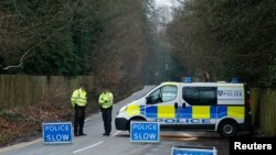 A police cordon blocks the road leading to Russian oligarch Boris Berezovsky's house, after he was found dead on March 23 at his home near Ascot in Berkshire.