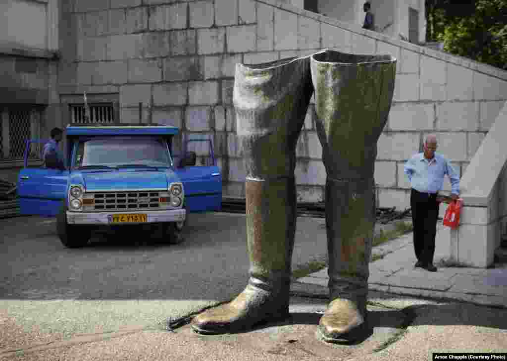 At the Saadabad Palace complex in northern Tehran, Islamic revolutionaries sawed a statue of the deposed Shah in half. Today schoolchildren pass by the boots on their way into the palace to see the decadence of the former Shah's living quarters.