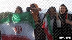 Female fans watch from a distance as the Iranian national soccer team trains in Tehran.