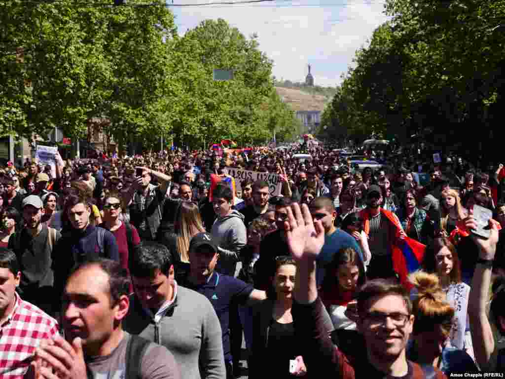 Unchallenged by police, huge crowd of mostly student demonstrators march down the central avenue of Yerevan.