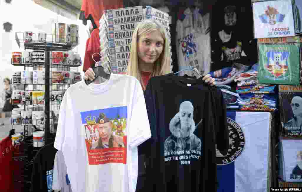 "A choice of slogans: one T-shirt declares the gratitude of the Serbian nation to Putin, while the other says, ""The Olympics May Be Over, But The Games Have Just Begun."""