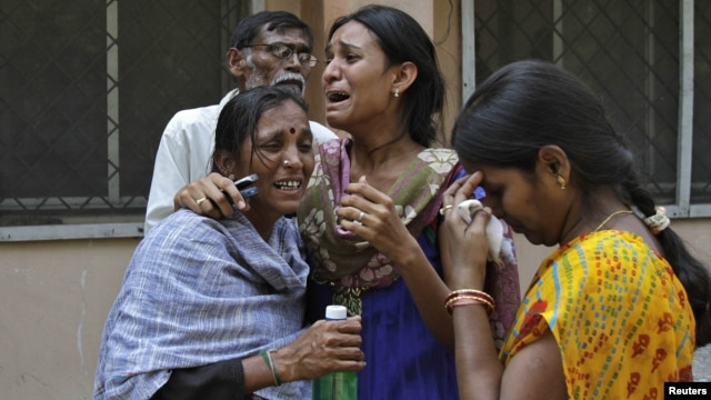 Women outside a mortuary in the southern Indian city of Hyderabad mourn the death of a relative who was killed in one of the February 21 explosions.