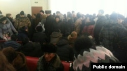 Clients line up at Kaspi Bank in Astana to withdraw their savings on February 18.