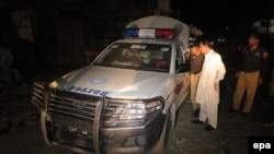 Pakistani police official inspect a vehicle after unknown assailants opened fire on the police vehicle in Quetta, the provincial capital of the restive Balochistan province on June 28.