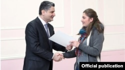 Armenia - Prime Minister Tigran Sarkisian gives a scholarship certificate to a Syrian Armenian woman studying at a university in Yerevan, 28Dec2012.