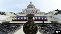 The United States Marine Corps Band practices on January 19 in front of the podium at the Capitol Building where U.S. President-elect Donald Trump was to take the oath of office and be sworn in as the 45th U.S. president in Washington.
