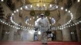 A municipality worker in a protective suit disinfects Kilic Ali Pasa Mosque due to coronavirus concerns in Istanbul, Turkey March 11, 2020. REUTERS/Kemal Aslan