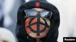 """Участник """"Русского марша"""" в Москве, 4 ноября 2014 года"""