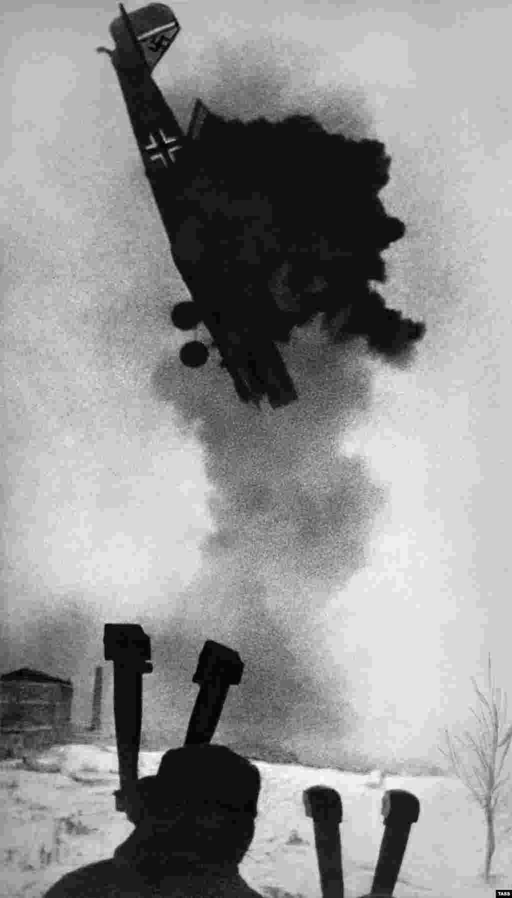 "Even the latest digital cameras would struggle to create a crisp image of an airplane plummeting to earth at close-range. This ""action"" photo from 1942 includes a hand-sketched tree as a bonus."