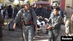 Afghan policemen carry the body of a civilian victim of a bomb blast -- is a continuation of strife and violence the only possible future for Afghanistan.