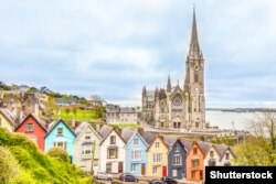Ireland - Cathedral and colored houses in Cobh, Ireland