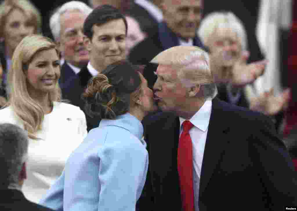 U.S. -- U.S. President-elect Donald Trump kisses his wife Melania as he attends his inauguration ceremonies on the Capitol in Washington, U.S., January 20, 2017.
