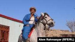 Abdul Rauf Amini, a chapandaz or buzkashi player, also grooms horses for the dangerous sport.