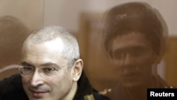 Mikhail Khodorkovsky sits before a court session starts in Moscow court in April.