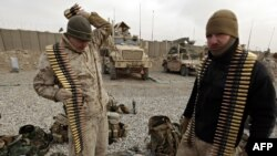 FILE: U.S. Marines check their gear at a company operation base (COB) in Helmand Province.