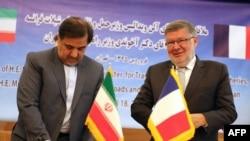 آلن ویدالی، وزیر حملونقل فرانسه (راست) در تهران با عباس آخوندی، همتای ایرانیاش.