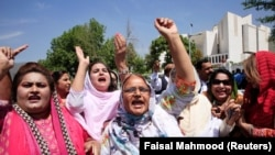 Supporters of former Pakistan Prime Minister Nawaz Sharif chant slogans following the Supreme Court decision to disqualify him from holding office for life.