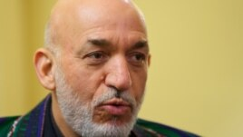Afghan President Hamid Karzai was presented with a collection of documents while visiting the United States.