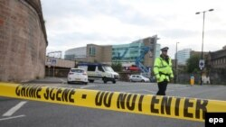 U.K. -- Members of the police stand behind a cordoned off area near the Manchester Arena in Manchester, Britain, 23 May 2017.