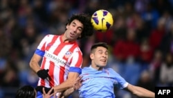 Spain -- Atletico Madrid's Arda Turan (L) vies with Celta's defender Hugo Mallo (R) during the Spanish League football match Atletico de Madrid vs Celta de Vigo at Vicente Calderon stadium in Madrid, 21Dec2012