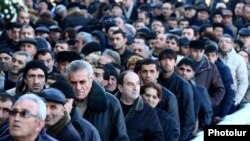 Armenia - Residents of Gyumri take part in the funeral of six members of a local family killed in their home, 15Jan2015.