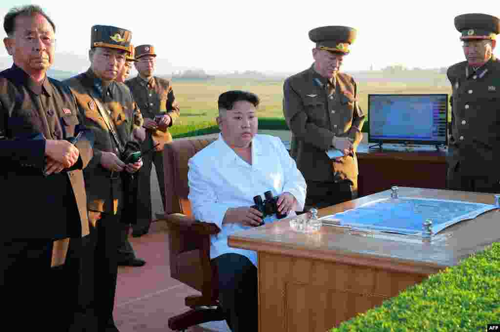 This undated picture released by North Korea's official Korean Central News Agency on May 28 shows North Korean leader Kim Jong Un (center) inspecting the test of a new antiaircraft weapons system at an undisclosed location. The North has carried out two atomic tests and dozens of ballistic-missile launches over the past year and a half. The nuclear program and missile tests have been banned by the UN, but Pyongyang has said they are necessary to counter U.S. aggression.