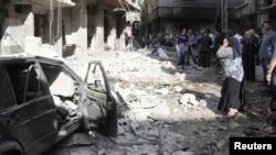 Pamje pas një shpërthimi në një lagje të kryeqytetit Damask në Siri ku kryengritësit po luftojnë kundër regjimit të presidentit Barash al-Assad