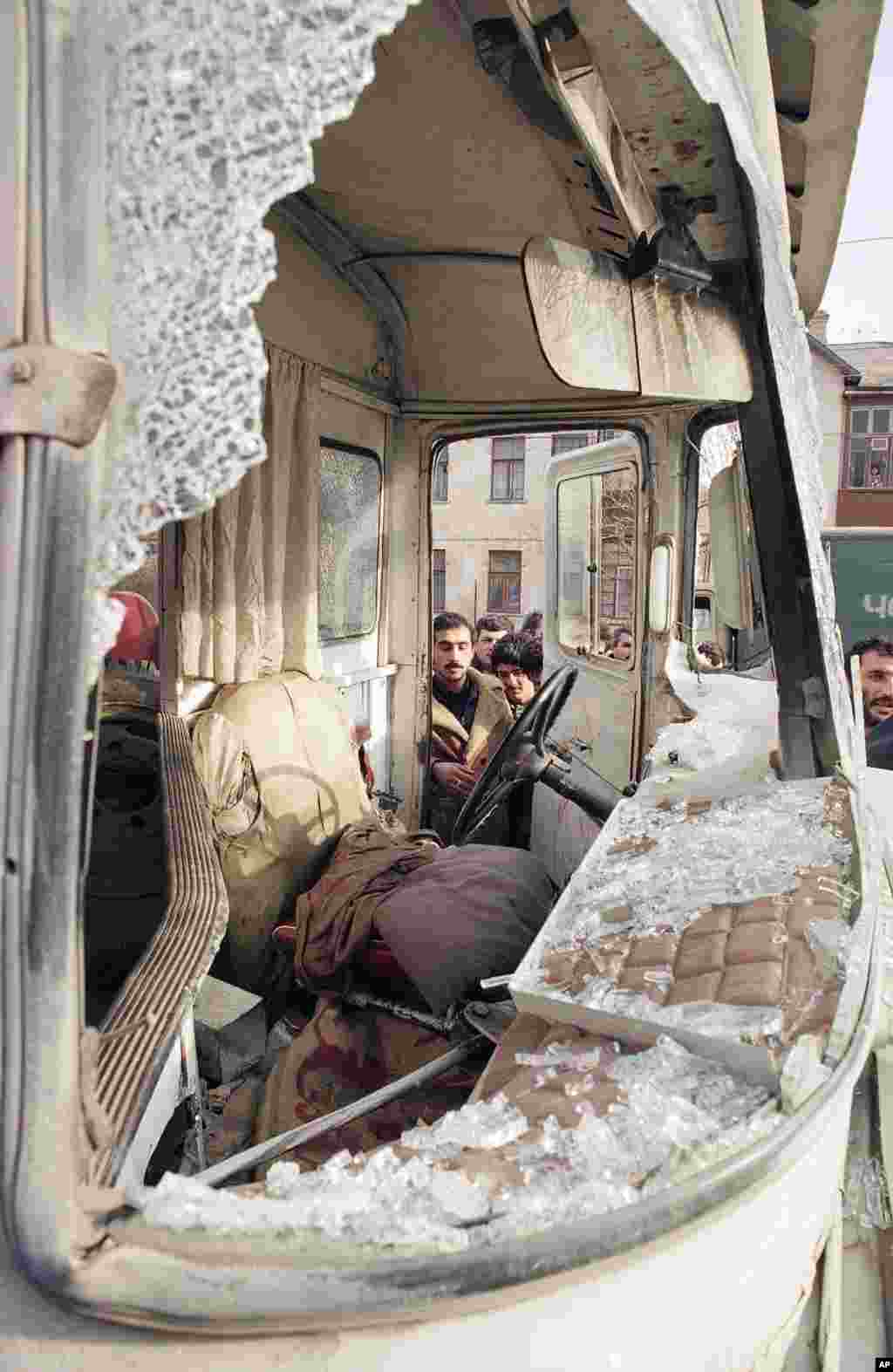 Baku residents inspect a bus that was shot up by Soviet troops on January 21.