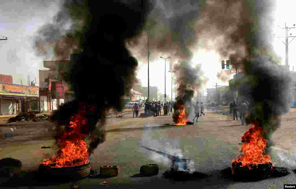 Sudanese protesters use burning tires to erect a barricade on a street, demanding that the country's Transitional Military Council hand over power to civilians in Khartoum on June 3.