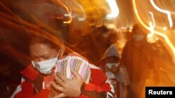 A woman covered her baby as she ran from ash erupting from Mount Merapi, on Java island.