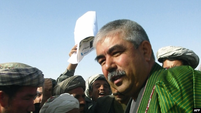 General Abdul Rashid Dostum greets supporters in the Sheberghan region during the 2004 Afghan presidential election.