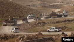 Vehicles belonging to Kurdish Peshmerga forces are seen in the town of Sinjar on November 12.