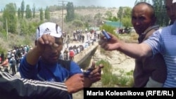 Protesters in Barskook, near the Kumtor mining operations, show shotgun shells after the main clashes on May 31.