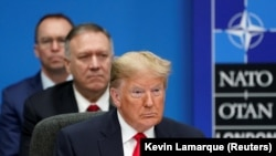 U.S. President Donald Trump, U.S. Secretary of State Mike Pompeo and Acting White House Chief of Staff Mick Mulvaney attend a North Atlantic Treaty Organization Plenary Session at the NATO summit in Watford, December 4, 2019