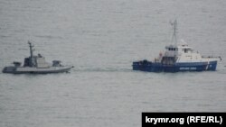 Ukrainian ships are seen being towed out of Kerch on November 17.