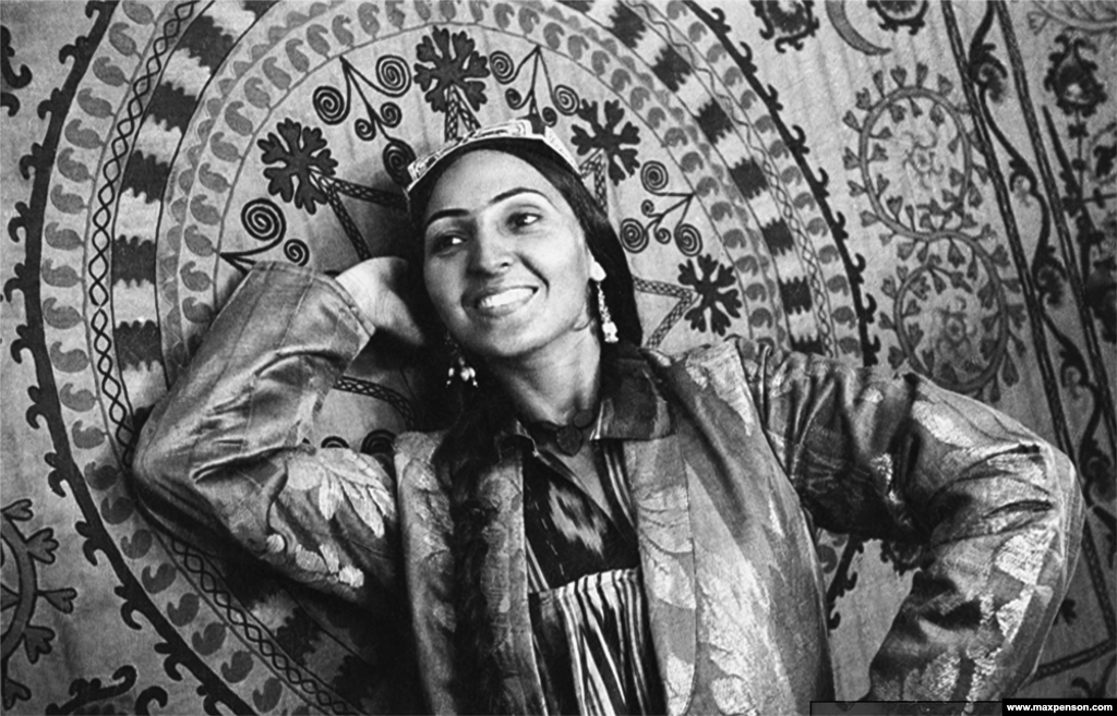 A woman poses with a panel of traditional Uzbek embroidery. Penson was soon employed by the Soviet newspaper Pravda Vostoka [Truth Of The East] to shoot Soviet propaganda images as well as daily life.