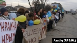 Women rallied in the Crimean city of Simferopol on March 8, International Women's Day, against war and occupation and for Ukrainian peace and unity.