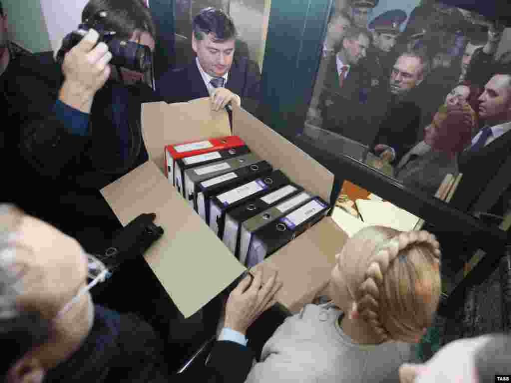 Prime Minister Yulia Tymoshenko and deputies from her bloc submit boxes of documents supporting their allegations of fraud in Ukraine's presidential election to the Supreme Administrative Court in Kyiv in February 2010.