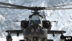 A U.S. Apache helicopter at a forward operating base in Nijrab, Afghanistan, in mid-February