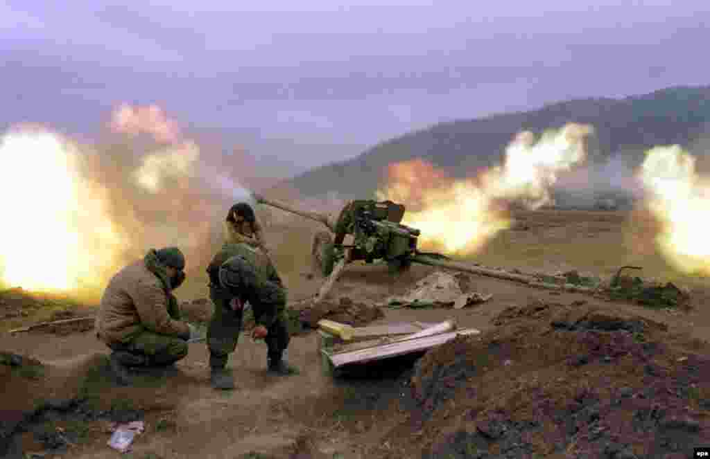 Russian federal soldiers fire at Chechen rebel positions. The ground assault was backed by heavy use of artillery and air power.