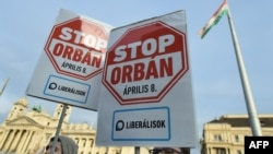 Placards opposing Hungarian Prime Minister Viktor Orban are raised ahead of the April 8 vote.
