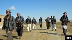 Members of an Afghan Local Police unit, also known as Arbaki, patrol in the northeastern Kunduz province, December, 2014/