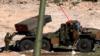 Сириядағы «Град» артиллериялық кешені мен ресейлік әскерилер.