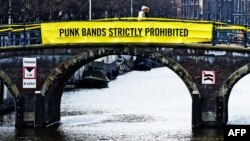 A banner on a bridge in Amsterdam mocks Russian President Vladimir Putin ahead of an April visit with a Pussy Riot allusion.
