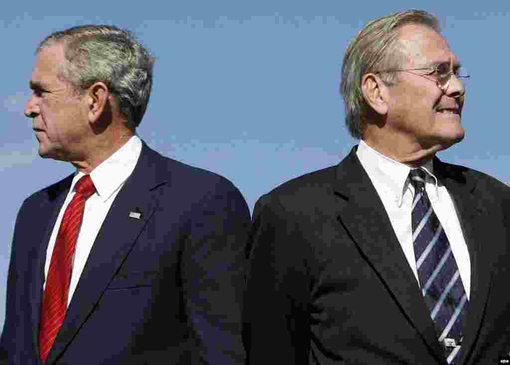 U.S. President George W. Bush (left) and Defense Secretary Donald Rumsfeld at the dedication of a U.S. Air Force Memorial in Arlington (epa) - Many observers argued that the midterm elections in the United States in November were a referendum on Washington's conduct of the war in Iraq. And the big casualty of the Republicans' defeat was the man charged with bringing security to Iraq: Defense Secretary Donald Rumsfeld. His departure was seen as ushering in a new approach -- prompting Iran and Syria to move to strengthen ties with Iraq.