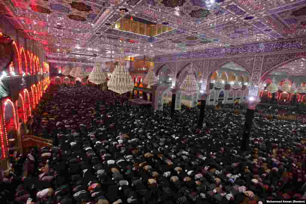 Shi'ite pilgrims pray at the shrine of Imam al-Hussein during the Shi'ite religious ceremony of Arbain in the holy Iraqi city of Karbala, southwest of Baghdad. (Reuters/Mohammed Ameen)