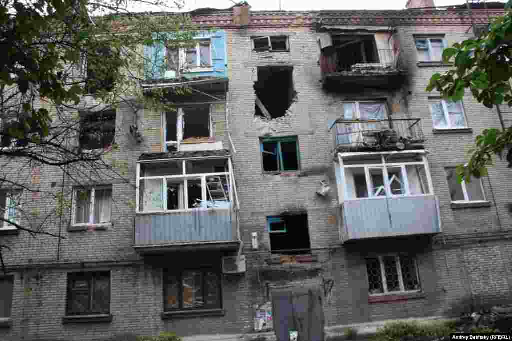 An apartment building damaged by shelling.