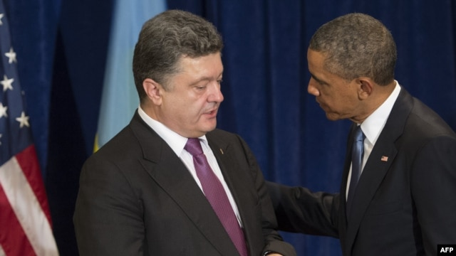 Poland -- US President Barack Obama and President-elect Petro Poroshenko of Ukraine talk during a meeting in Warsaw, June 4, 2014