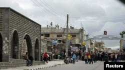 Protesters gather near the Al-Omari Mosque in the southern city of Daraa on March 22.