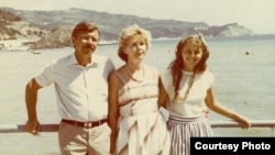 Natalia Churikova (right) poses with her stepfather, Oleksander Pavlenko, and her mother, Valentyna Pavlenko, on holiday in Crimea in 1987 -- one year after the disaster at Chornobyl.